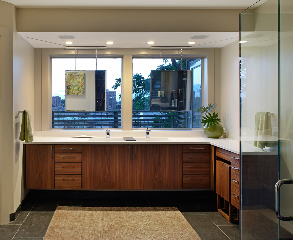 Inspiration for a contemporary corner shower remodel in Kansas City with a trough sink, flat-panel cabinets and dark wood cabinets