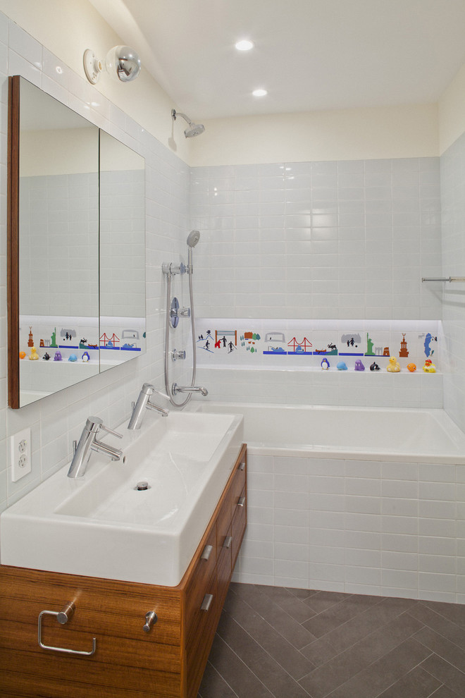 Bathroom - modern kids' white tile and subway tile bathroom idea in New York with a trough sink, flat-panel cabinets and medium tone wood cabinets