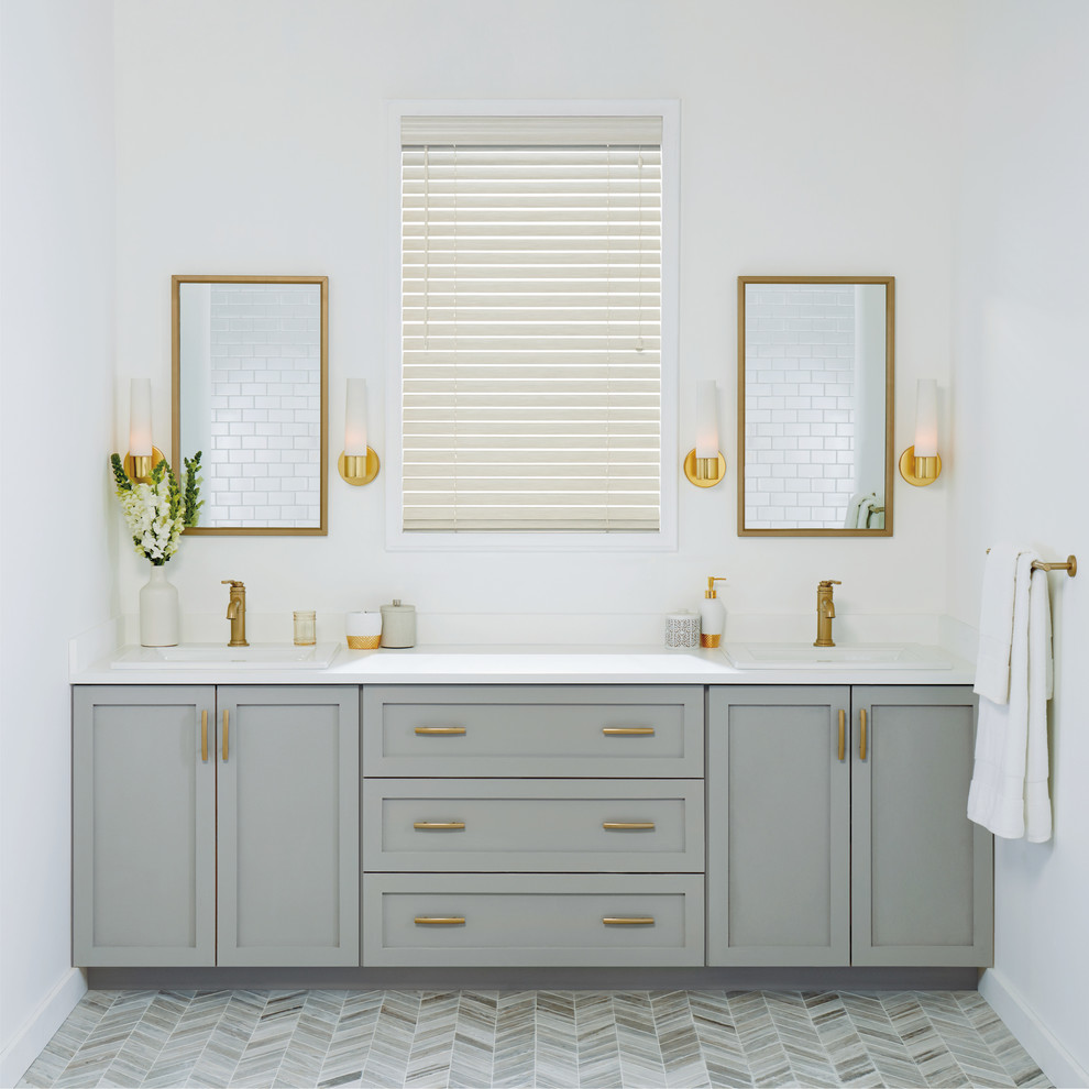 Example of a mid-sized transitional master gray floor and porcelain tile bathroom design in New York with shaker cabinets, gray cabinets, white walls, a drop-in sink, quartz countertops and white countertops