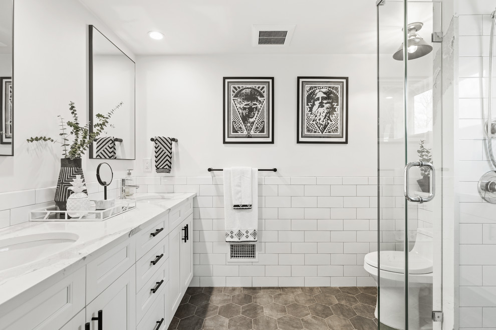 Transitional white tile and subway tile gray floor alcove shower photo in New York with recessed-panel cabinets, white cabinets, white walls, an undermount sink and white countertops