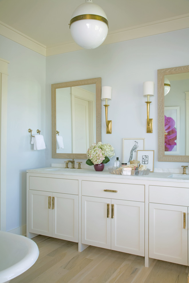 Island style bathroom photo in Charleston with shaker cabinets and white cabinets