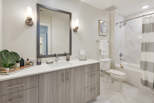 Example of a mid-sized trendy kids' white tile and marble tile marble floor and gray floor bathroom design in Atlanta with flat-panel cabinets, a two-piece toilet, quartzite countertops, white countertops, gray cabinets, gray walls and an undermount sink
