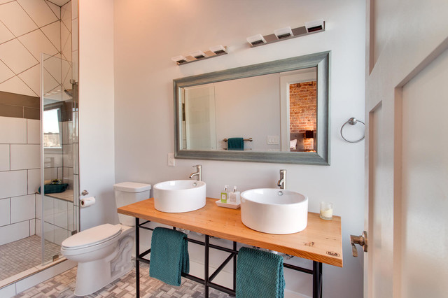 Bathroom - mid-sized transitional 3/4 gray tile and stone tile porcelain floor bathroom idea in DC Metro with a vessel sink, a two-piece toilet, gray walls, wood countertops and brown countertops