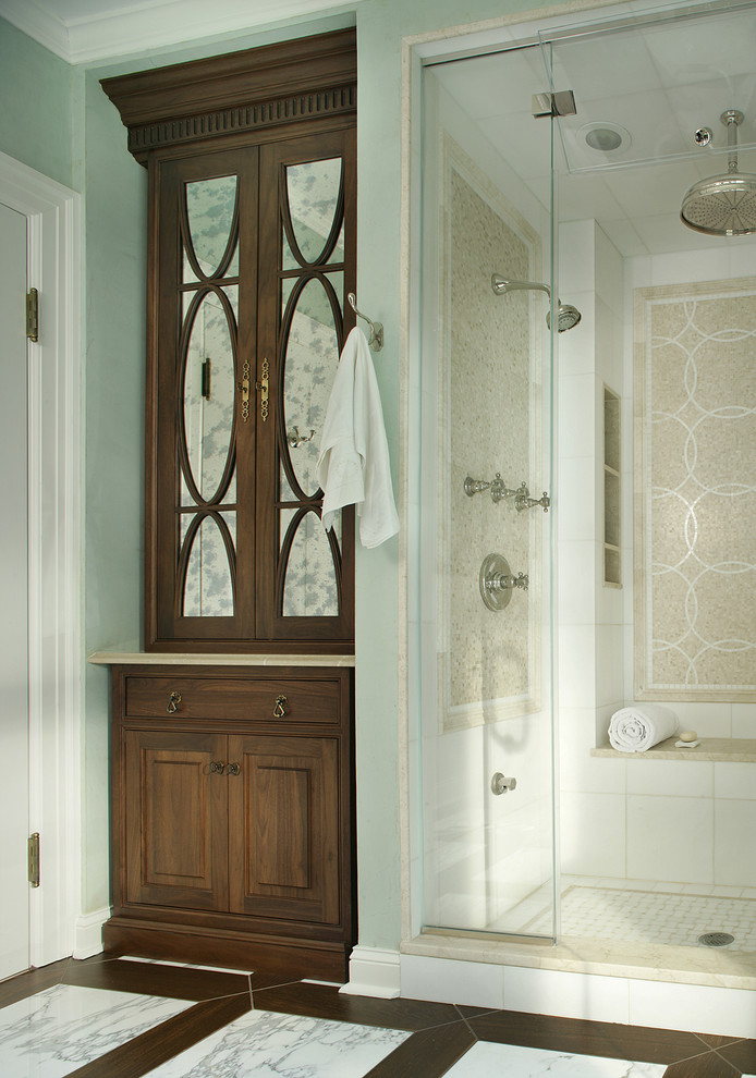 Bathroom - mid-sized traditional master white tile, beige tile and stone tile marble floor and white floor bathroom idea in New York with dark wood cabinets, beaded inset cabinets, green walls, an undermount sink, a two-piece toilet, limestone countertops and a hinged shower door