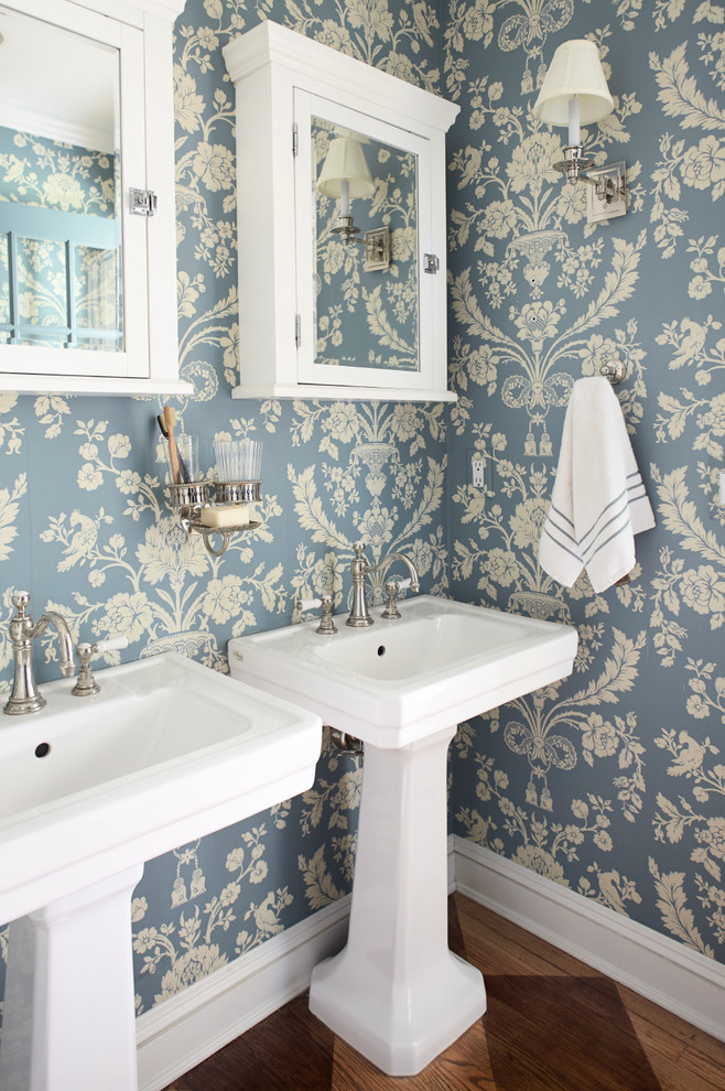 Bathroom - mid-sized shabby-chic style master dark wood floor bathroom idea in New York with a pedestal sink, blue walls, glass-front cabinets and white cabinets
