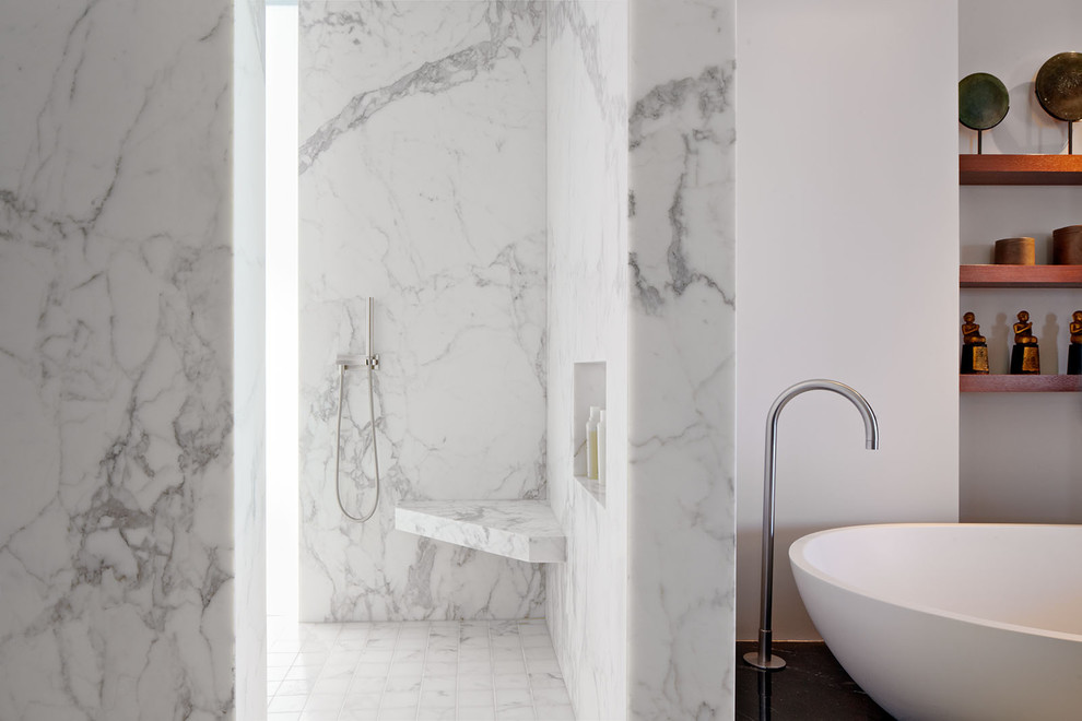 Shower bench - modern marble tile shower bench idea in San Francisco with a niche
