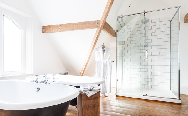 Scandi Bathroom In Manchester With A Claw Foot Bath, White Tiles, Metro  Tiles