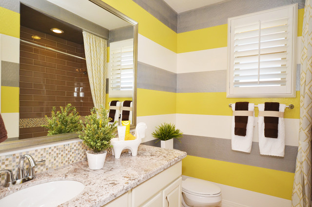 Example of a mid-sized classic kids' gray tile and porcelain tile porcelain floor bathroom design in Phoenix with a drop-in sink, raised-panel cabinets, white cabinets, engineered quartz countertops, a one-piece toilet and yellow walls