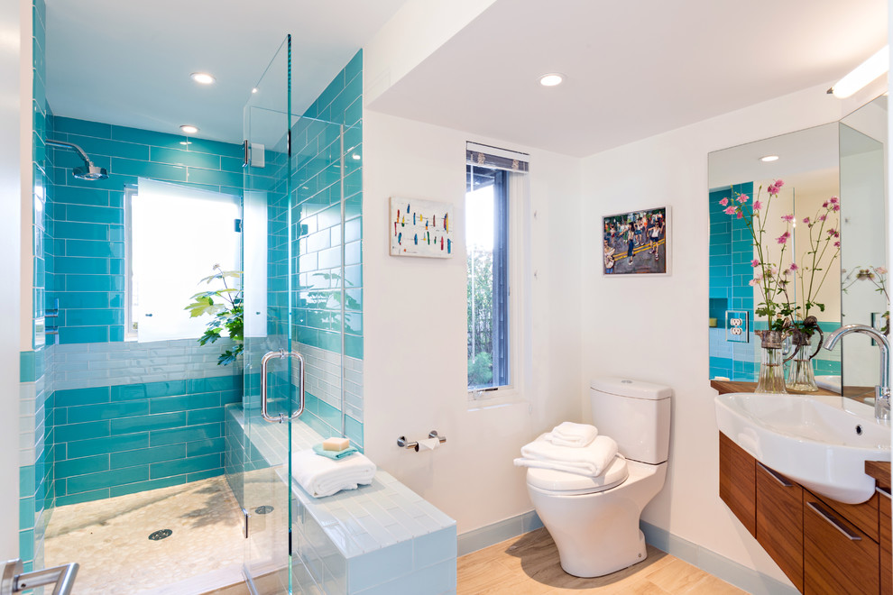 Inspiration for a coastal glass tile and blue tile light wood floor bathroom remodel in Boston with flat-panel cabinets, dark wood cabinets, white walls and wood countertops