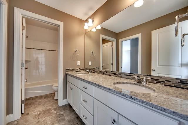 Jack & Jill Bathroom - Audubon Model - 2014 Spring Parade of Homes transitional-bathroom