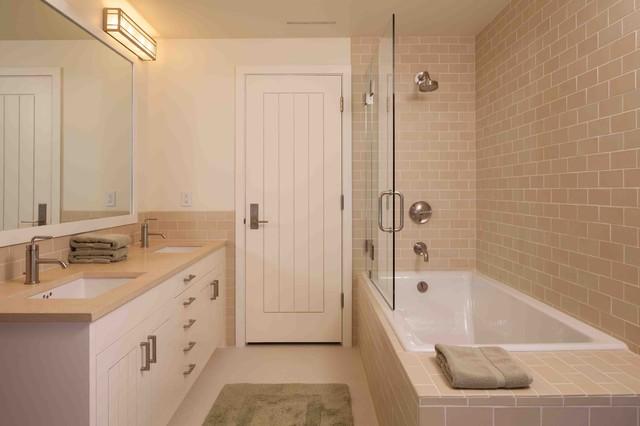 Example Of A Mountain Style Subway Tile Bathroom Design In Portland