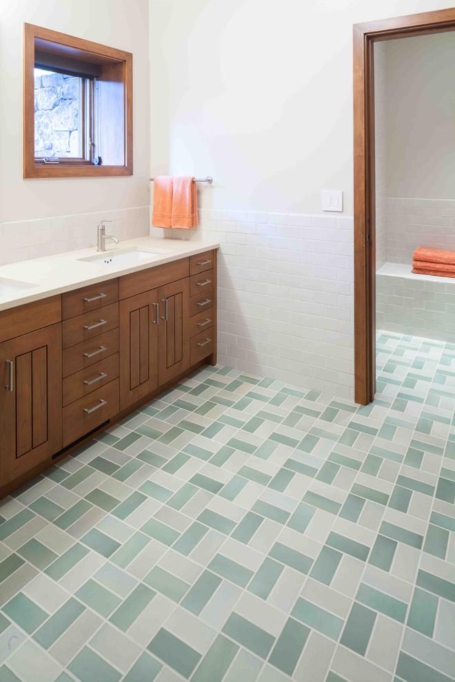 Inspiration for a rustic subway tile green floor bathroom remodel in Portland