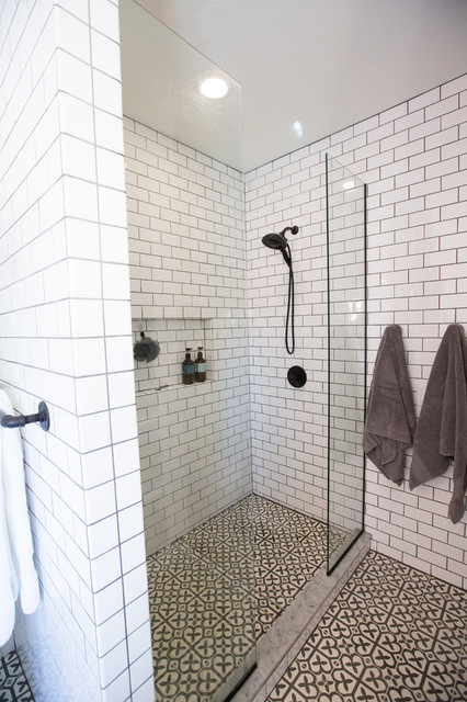 Example of a small eclectic master white tile and ceramic tile concrete floor and gray floor bathroom design in Other with furniture-like cabinets, black cabinets, white walls, an undermount sink, marble countertops and white countertops