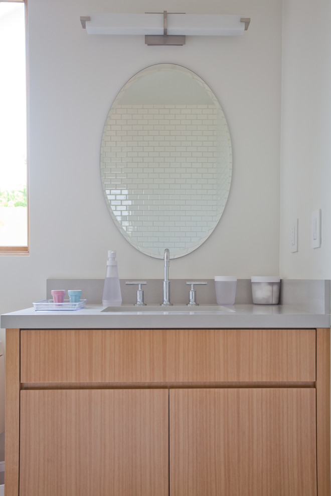 Inspiration for a contemporary bathroom remodel in Los Angeles with flat-panel cabinets and light wood cabinets