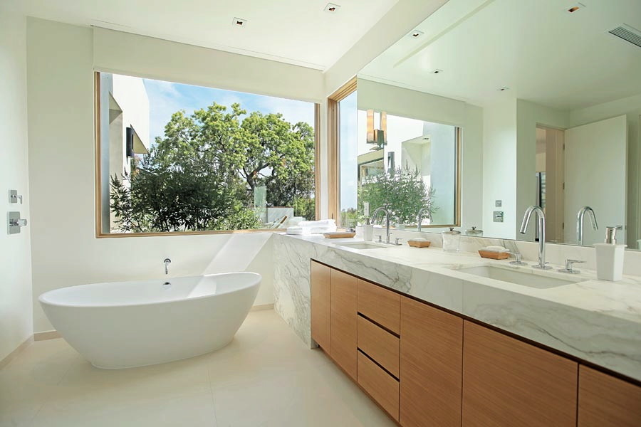 Example of a large 1960s master beige tile and porcelain tile ceramic tile bathroom design in Los Angeles with an undermount sink, flat-panel cabinets, medium tone wood cabinets, marble countertops, a one-piece toilet and white walls