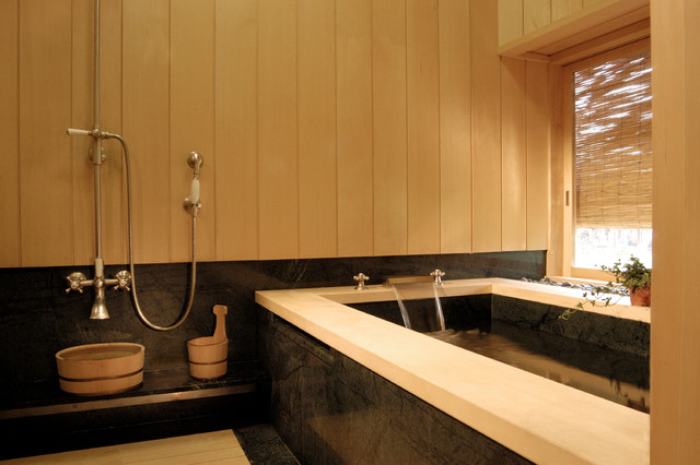 Japanese style bathing room with granite soaking tub for Asian small bathroom design