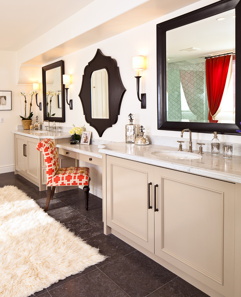 Bathroom - large mediterranean master gray tile and porcelain tile slate floor and gray floor bathroom idea in Orange County with an undermount sink, recessed-panel cabinets, beige cabinets, white walls, marble countertops and a hinged shower door