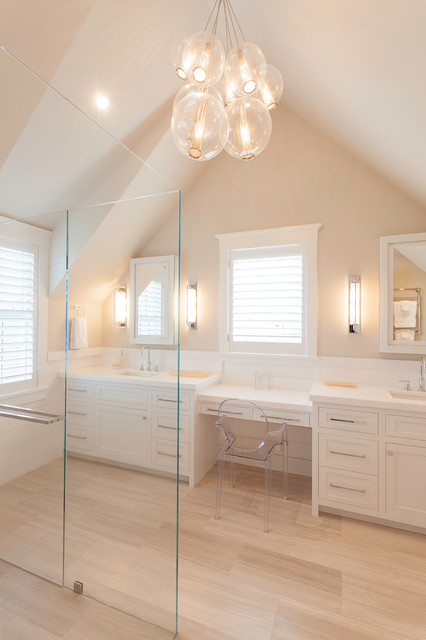 Example of a large coastal master light wood floor walk-in shower design in Boston with an undermount sink, shaker cabinets, white cabinets and beige walls