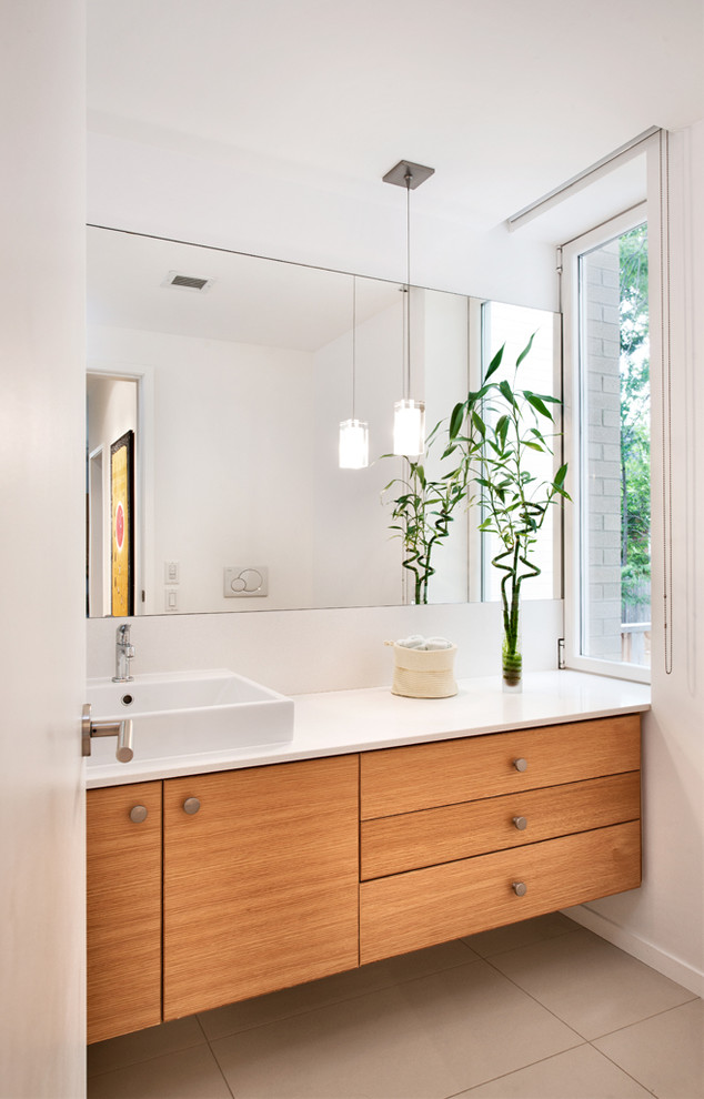Bathroom - contemporary bathroom idea in Toronto with flat-panel cabinets, medium tone wood cabinets, white walls and a vessel sink