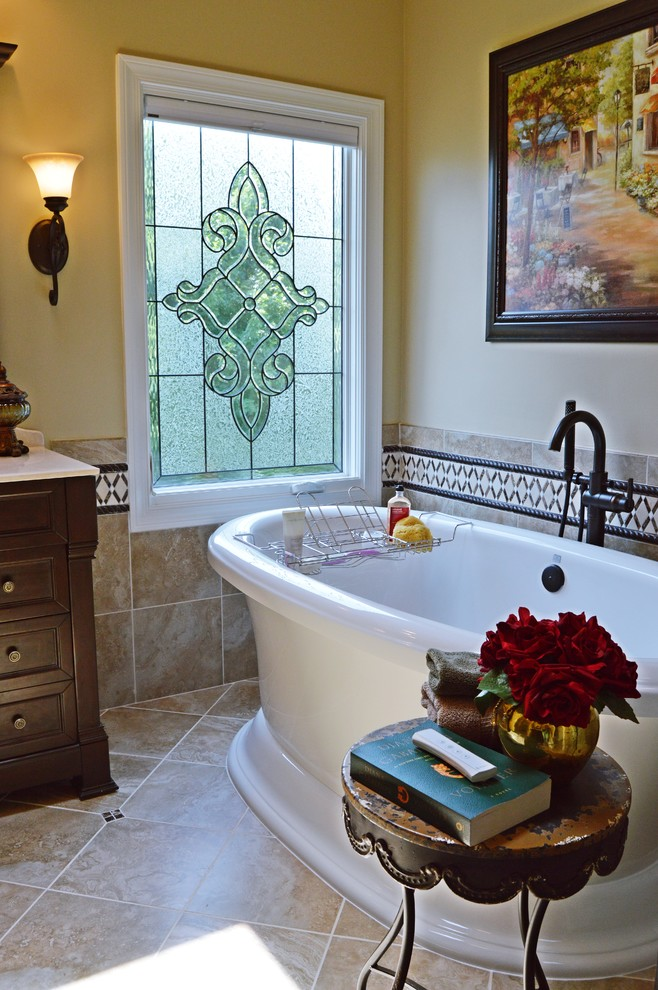 Inspiration for a large timeless master beige tile and porcelain tile porcelain tile bathroom remodel in Atlanta with furniture-like cabinets, dark wood cabinets, an undermount sink, granite countertops, a one-piece toilet and beige walls