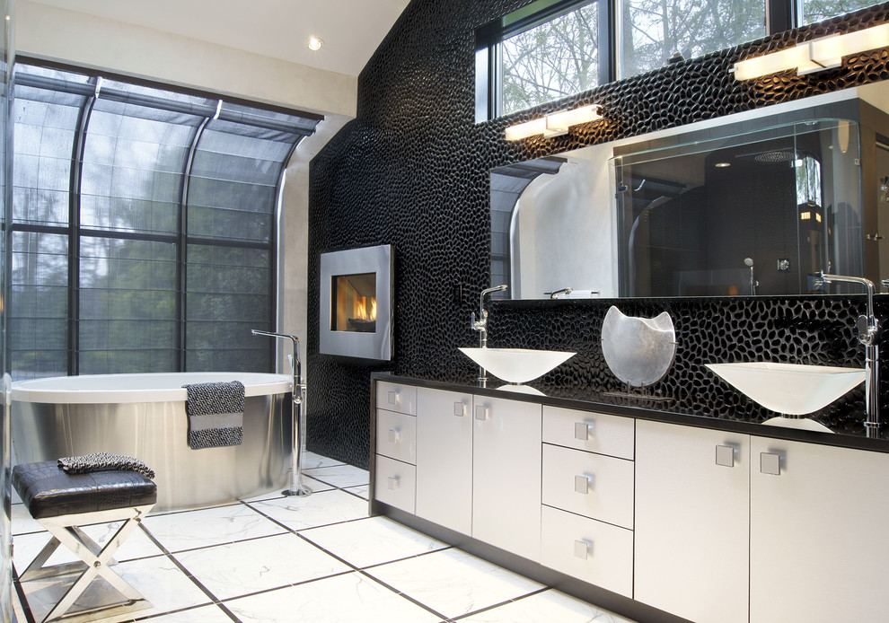 Minimalist bathroom photo in New York with a vessel sink and black walls