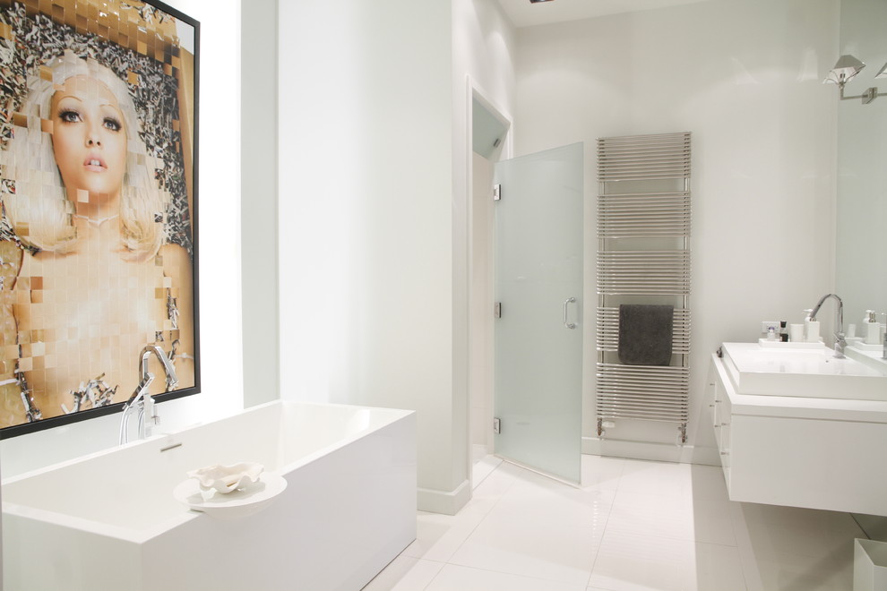 Example of a trendy freestanding bathtub design in Montreal