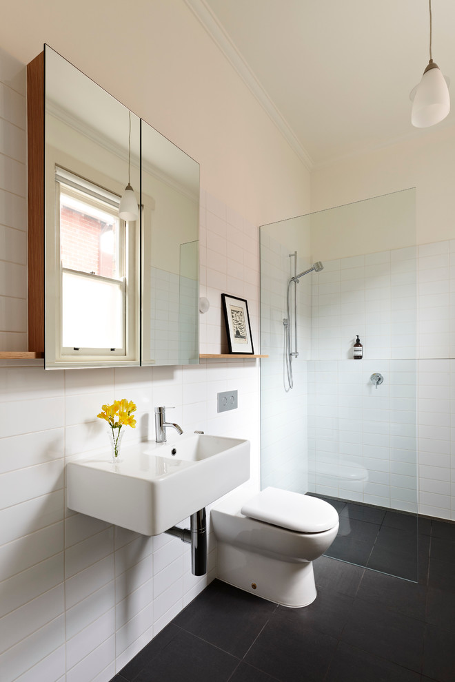 Inspiration for a modern walk-in shower remodel in Melbourne with a wall-mount sink