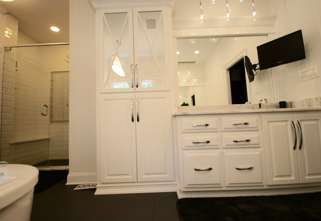 Bathroom - contemporary ceramic floor bathroom idea in Atlanta with raised-panel cabinets, white cabinets, marble countertops and white walls
