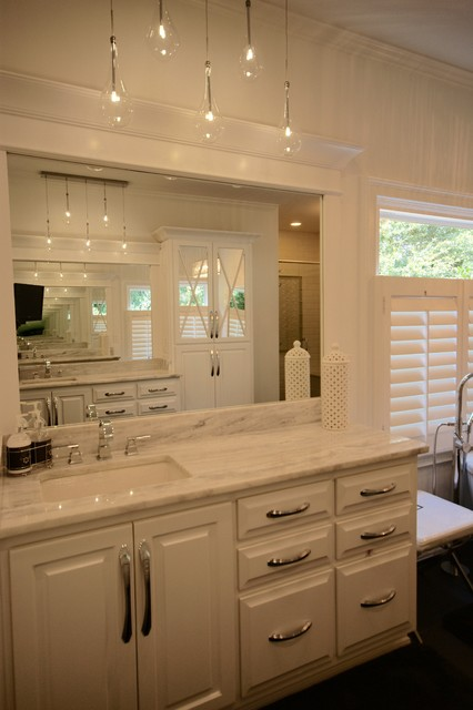 Trendy master ceramic floor bathroom photo in Atlanta with an undermount sink, raised-panel cabinets, white cabinets, marble countertops and white walls