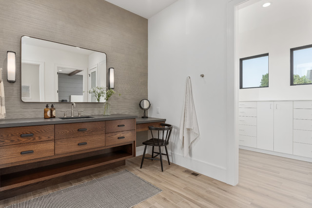 Large trendy master gray tile and porcelain tile porcelain floor and beige floor corner shower photo in Salt Lake City with flat-panel cabinets, medium tone wood cabinets, a one-piece toilet, white walls, an undermount sink, quartzite countertops, a hinged shower door and gray countertops