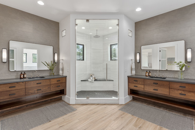 Corner shower - large contemporary master gray tile and porcelain tile porcelain floor and beige floor corner shower idea in Salt Lake City with flat-panel cabinets, medium tone wood cabinets, a one-piece toilet, white walls, an undermount sink, quartzite countertops, a hinged shower door and gray countertops