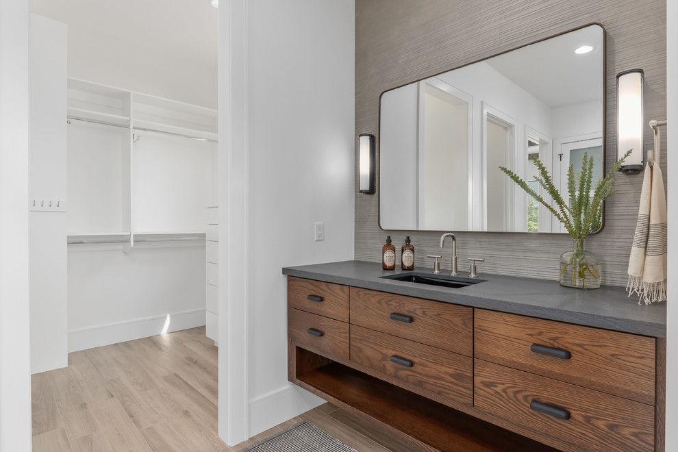 Inspiration for a large contemporary master gray tile and porcelain tile porcelain tile and beige floor corner shower remodel in Salt Lake City with flat-panel cabinets, medium tone wood cabinets, a one-piece toilet, white walls, an undermount sink, quartzite countertops, a hinged shower door and gray countertops
