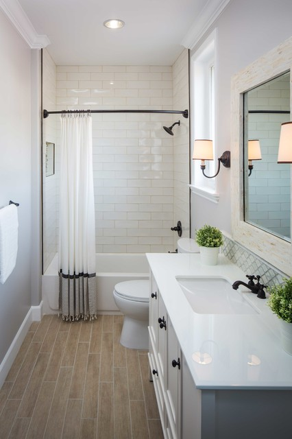 Bathroom - large transitional stone tile and white tile bathroom idea in Los Angeles with an undermount sink, white cabinets, gray walls and recessed-panel cabinets