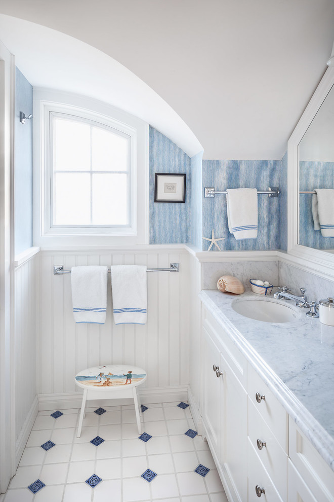 Beach style kids' white tile multicolored floor bathroom photo in Portland Maine with an undermount sink, recessed-panel cabinets, white cabinets, blue walls and gray countertops