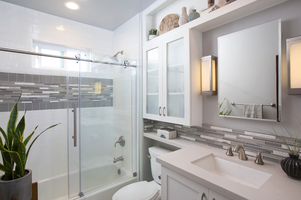 Example of a mid-sized trendy kids' white tile, gray tile and matchstick tile white floor and mosaic tile floor bathroom design in Denver with shaker cabinets, white cabinets, quartz countertops, a one-piece toilet, gray walls and an undermount sink