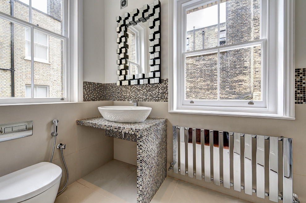 Bathroom - small transitional bathroom idea in London with a bidet, beige walls, tile countertops and a vessel sink