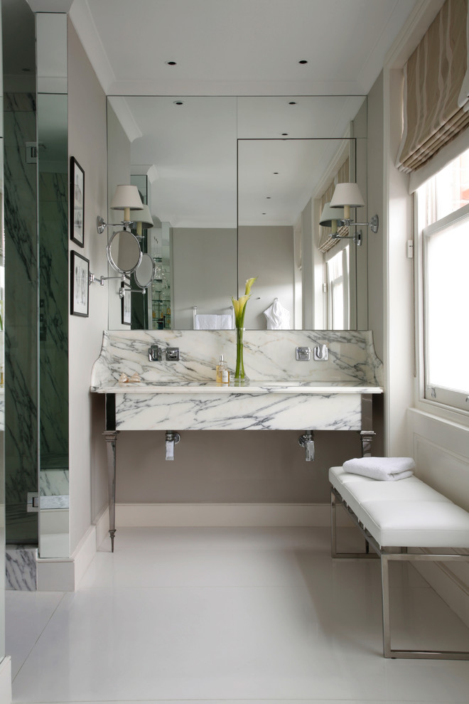 Inspiration for a transitional marble tile bathroom remodel in Dorset with a trough sink and marble countertops