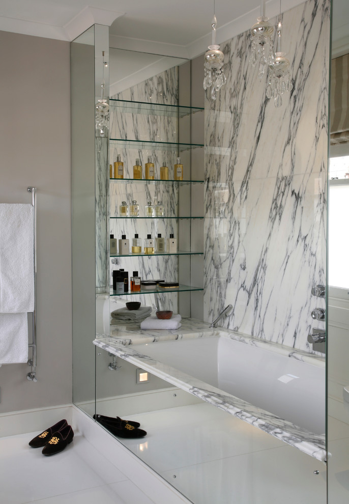 Design ideas for a contemporary bathroom in Dorset with a submerged bath, grey walls, white tiles and marble tiles.