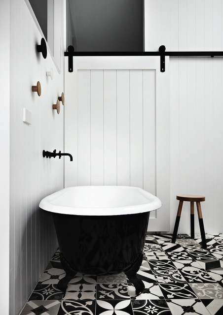 Inspiration for a contemporary concrete floor and multicolored floor claw-foot bathtub remodel in Melbourne with white walls