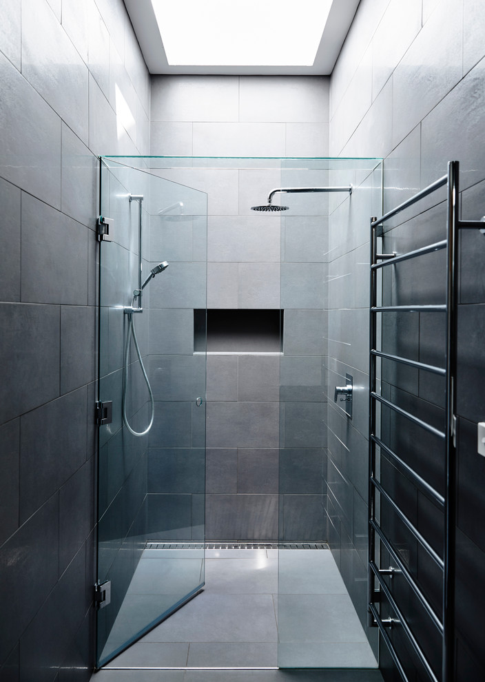 Bathroom - mid-sized modern master gray tile and ceramic tile ceramic tile bathroom idea in Melbourne with a one-piece toilet, gray walls, an undermount sink and a hinged shower door