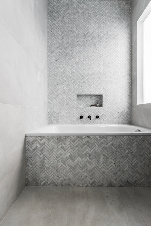 built in bath as a focal feature in the bathroom