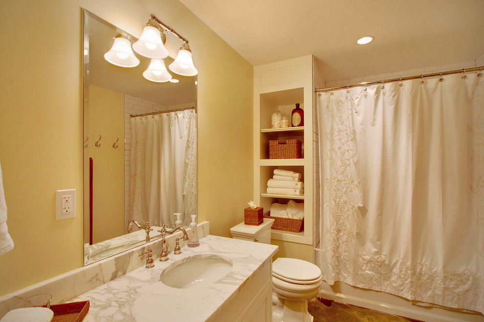 Bathroom - traditional bathroom idea in Seattle with an undermount sink and a two-piece toilet