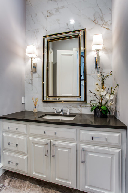 Inspiration for a transitional beige tile and white tile beige floor bathroom remodel in Dallas with raised-panel cabinets, white cabinets, gray walls, an undermount sink and black countertops