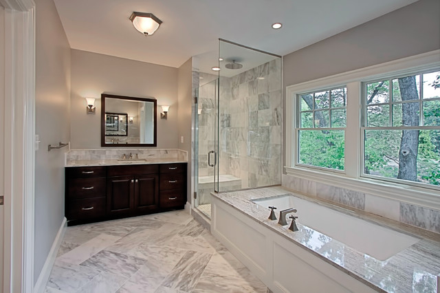 Inspiration for a medium sized classic bathroom in DC Metro with grey walls, raised-panel cabinets, dark wood cabinets, a submerged bath, a corner shower, grey tiles, marble tiles, marble flooring, a submerged sink, marble worktops, grey floors and a hinged door.