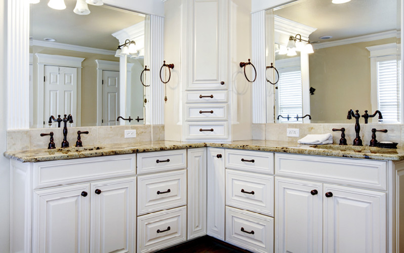 Mid-sized elegant master bathroom photo in Albuquerque with raised-panel cabinets, white cabinets, white walls, an undermount sink and granite countertops