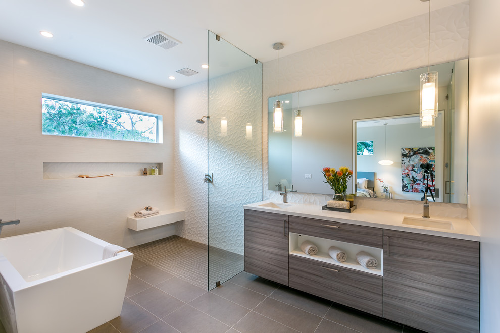 Example of a trendy master white tile and porcelain tile bathroom design in Los Angeles with an undermount sink, flat-panel cabinets, gray cabinets, quartz countertops and white walls