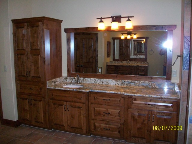 Knotty alder custom cabinets traditional-bathroom