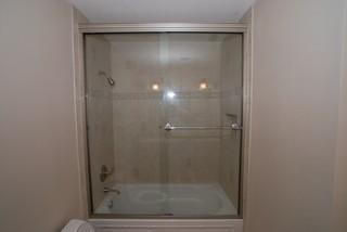 Kohler Devonshire Tub With Recessed Shampoo Shelf & Tall Shower Doors - Traditional - Bathroom ...