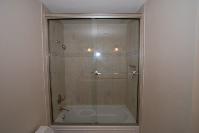 Kohler Devonshire Tub With Recessed Shampoo Shelf & Tall Shower Doors ...