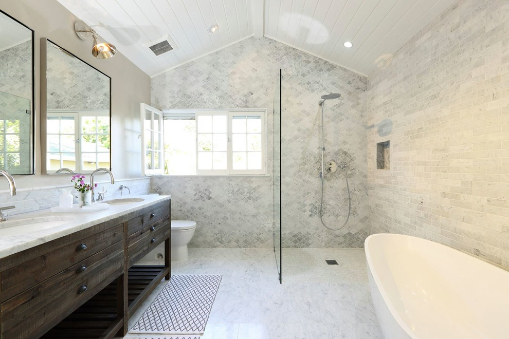 Inspiration for a transitional bathroom remodel in Los Angeles with an undermount sink, furniture-like cabinets, dark wood cabinets and a two-piece toilet